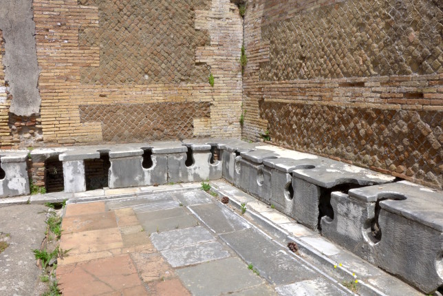 The latrines. Close quarters probably made for lively conversations.