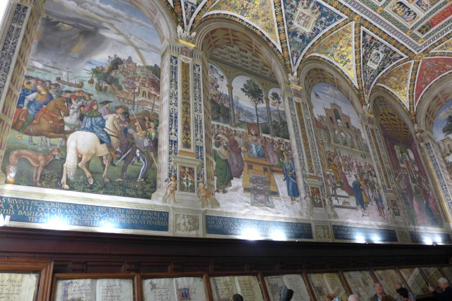 More frescoes with book row below