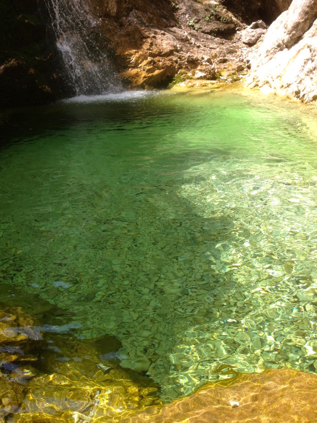Emerald green, crystal clear water